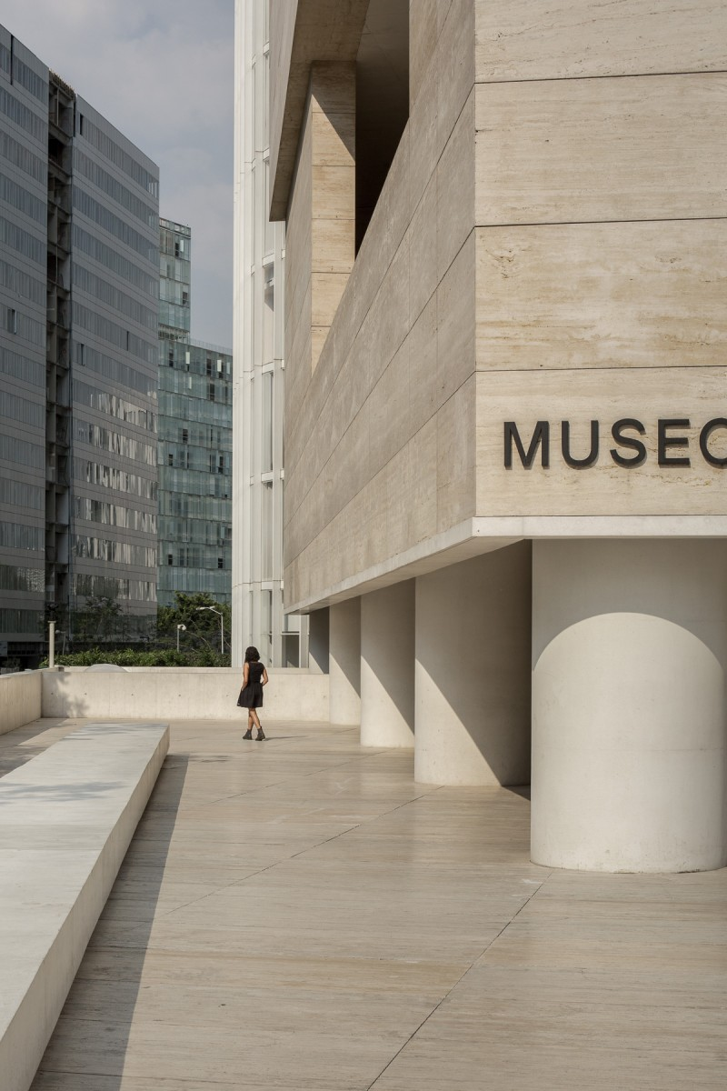 Woman walking out of Museo Jumex