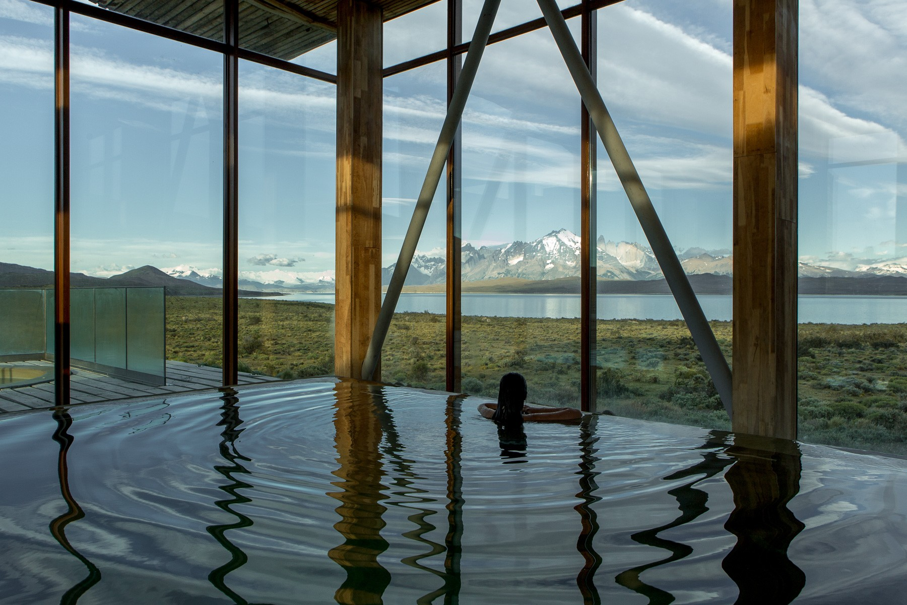 girl swimming with Torres del Paine in bacgkround